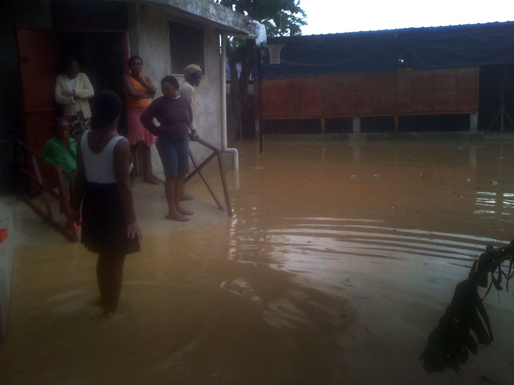 staff_viewing_flooded-yard_01